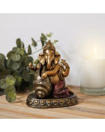 bronze colour ganesh and shell ornament on shelf 5017224886513